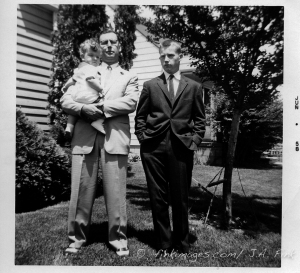 My father with me, the baby, and my big brother Joe on the lawn of our small house in Detroit in 1958.